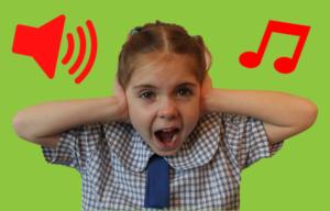 School girl covering ears